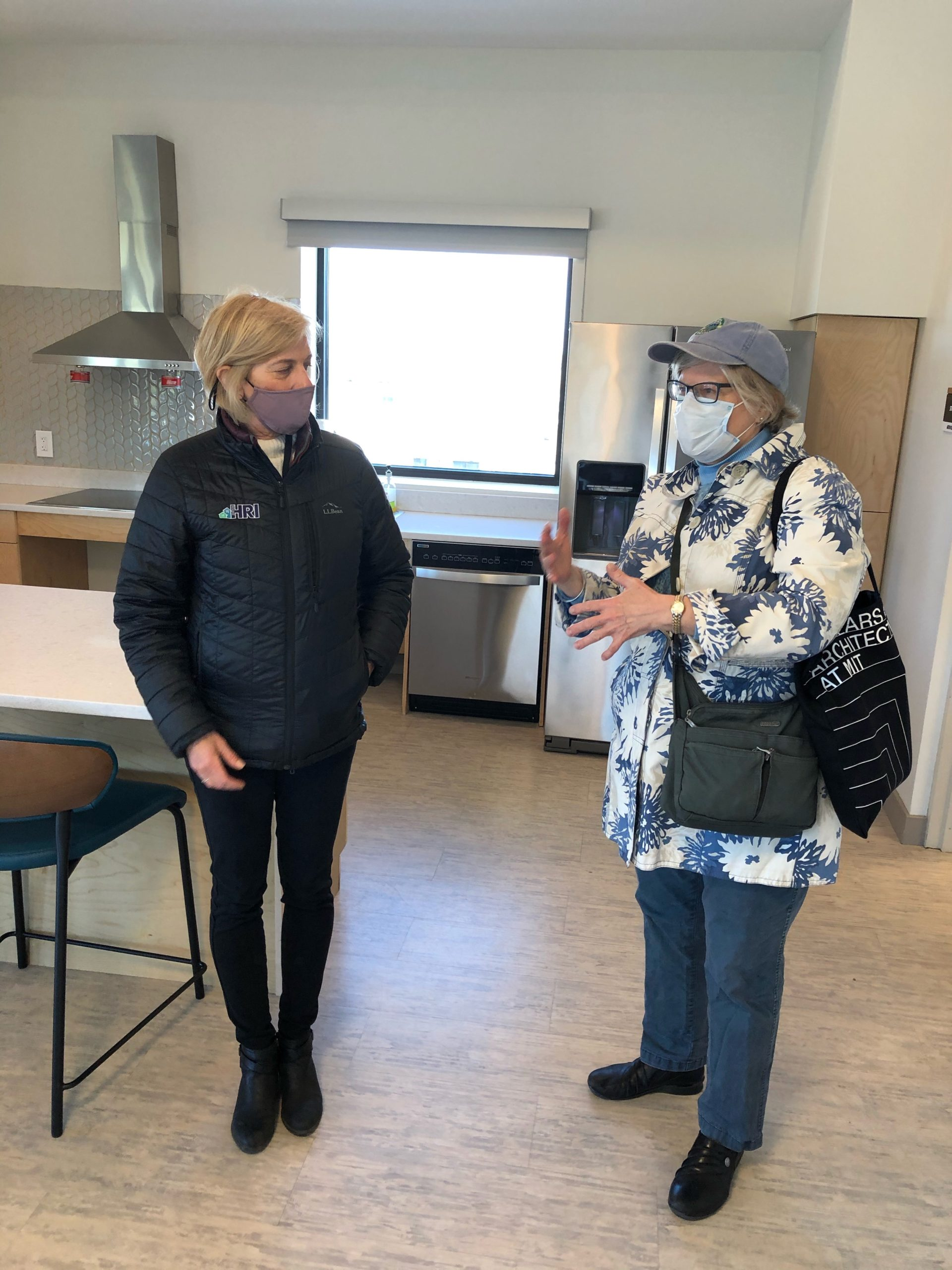 Jane and Kim chat in the community room