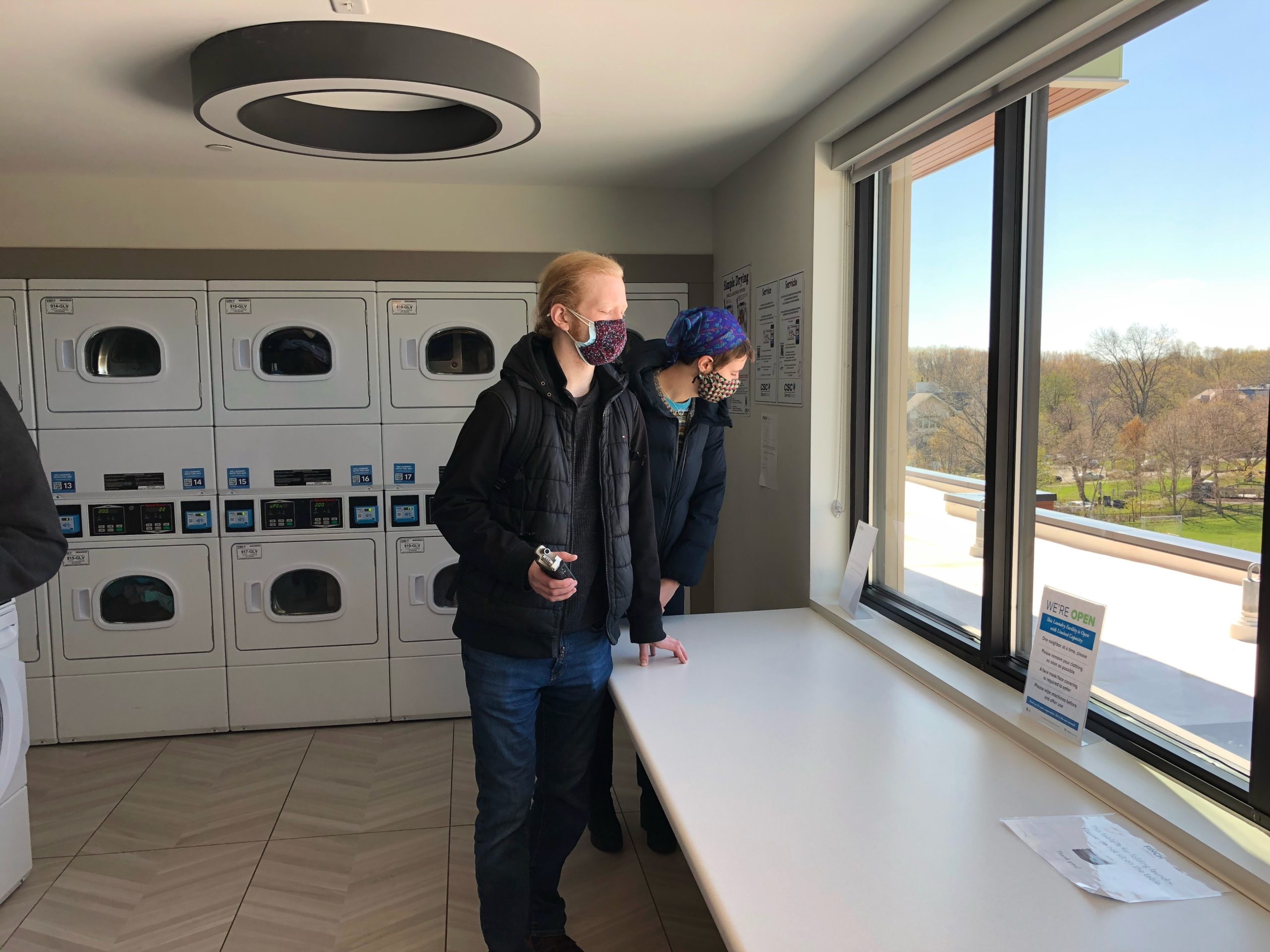 Carl-Isaak and Klara check out the views from the laundry room